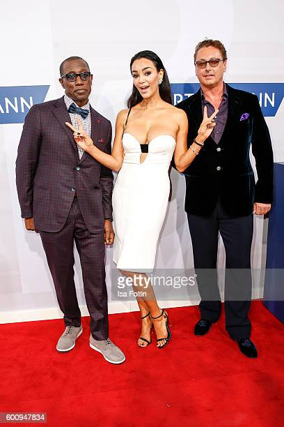 US actor Wesley Snipes Verona Pooth and Bernhard Fritsch attend the Bertelsmann Summer Party at Bertelsmann Repraesentanz on September 8 2016 in...