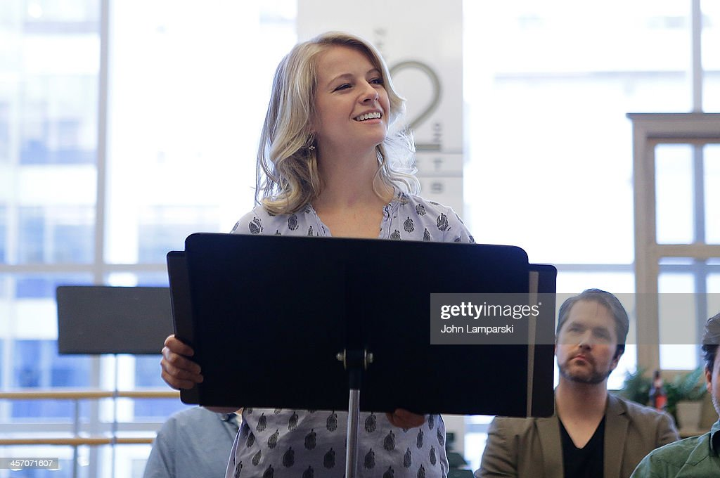 Actor Whitney Bashor (c) and cast perform 'The Bridges of Madison County' Cast Photo Call at The New 42nd Street Studios on December 16, 2013 in New York City.