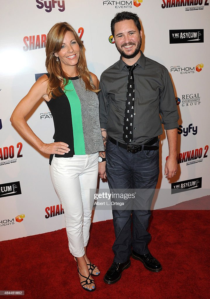Actor <a gi-track='captionPersonalityLinkClicked' href=/galleries/search?phrase=Wil+Wheaton&family=editorial&specificpeople=810615 ng-click='$event.stopPropagation()'>Wil Wheaton</a> and wife Anne Wheaton arrive for the Premiere Of The Asylum & Fathom Events' 'Sharknado 2: The Second One' held at Regal Cinemas L.A. Live on August 21, 2014 in Los Angeles, California.