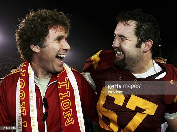 Actor Will Ferrell and Ryan Kalil of the USC Trojans celebrate a 239 win over the California Golden Bears during the game at the Los Angeles Memorial...