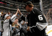 Actor Will Ferrell high fives a fan after the Los Angeles Kings win Game One of the 2014 Stanley Cup Final over the New York Rangers in overtime at...