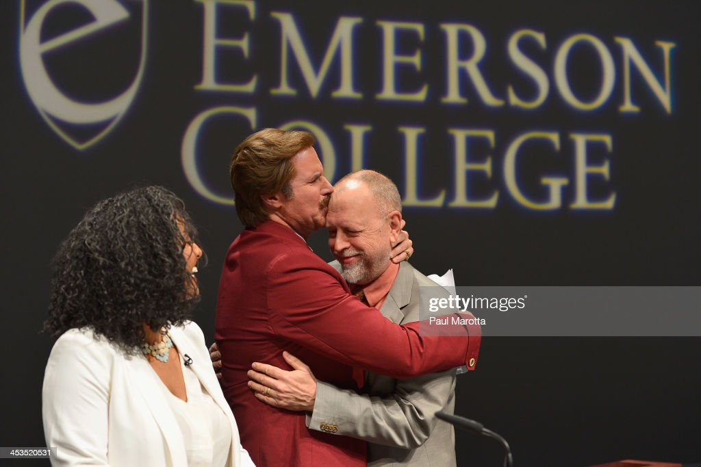 Actor Will Ferrell in character as Ron Burgundy hugs Emerson College Dean Phil Glenn as Emerson College renames the School of Communications the 'Ron...