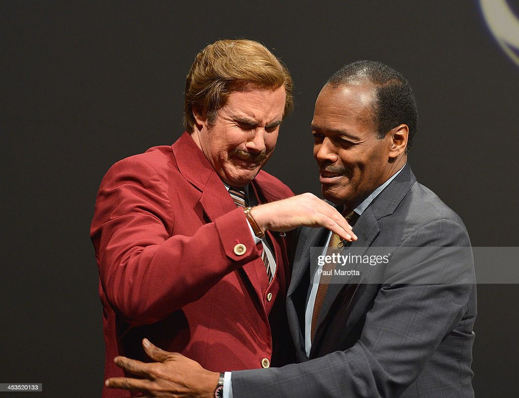 Actor Will Ferrell in character as Ron Burgundy is overcome with emotion as he hugs Emerson College President Lee Pelton as Emerson College renames...