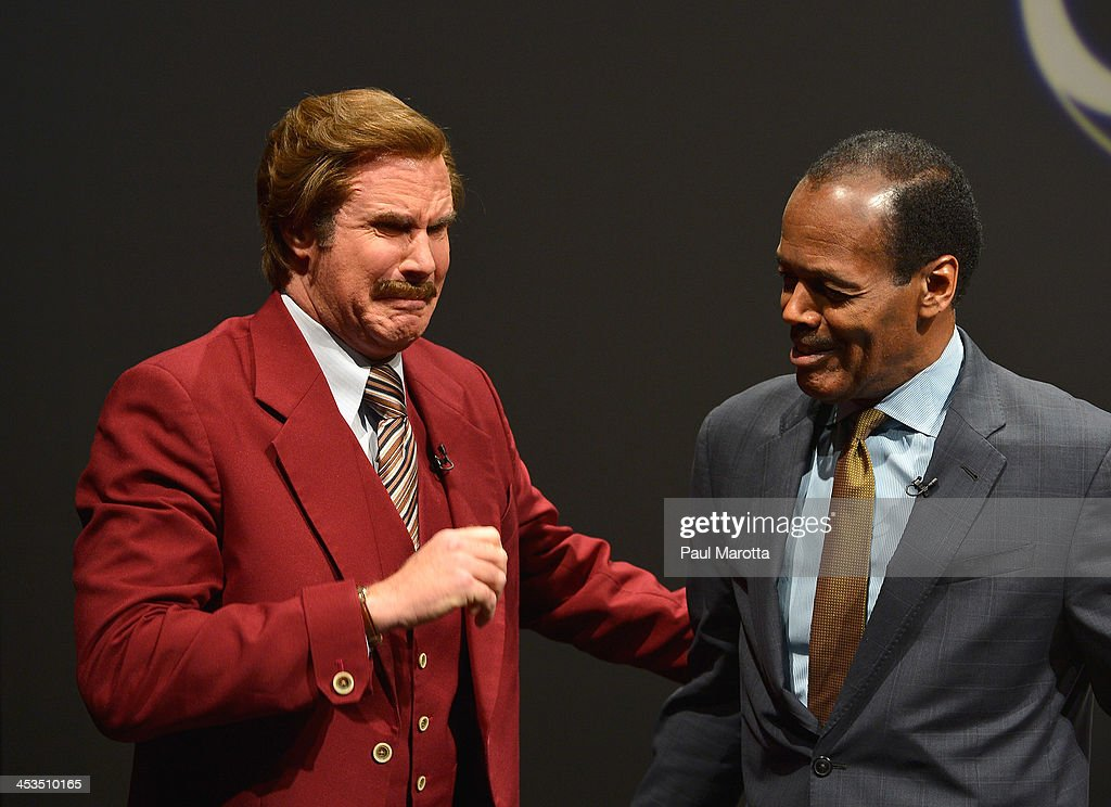 Actor Will Ferrell in character as Ron Burgundy is overcome with emotion beside Emerson College President Lee Pelton as Emerson College renames the...