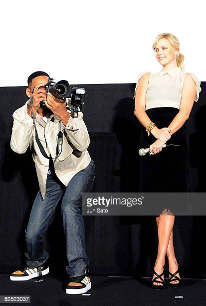 Actor Will Smith and actress Charlize Theron attend the 'Hancock' Stage Greeting at Shinjuku Piccadilly on August 23 2008 in Tokyo Japan The film...