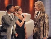 Actor Will Smith and actress Eva Mendes give host Thomas Gottschalk advice on how to dance on the 'Wetten Dass' television entertainment show at the...