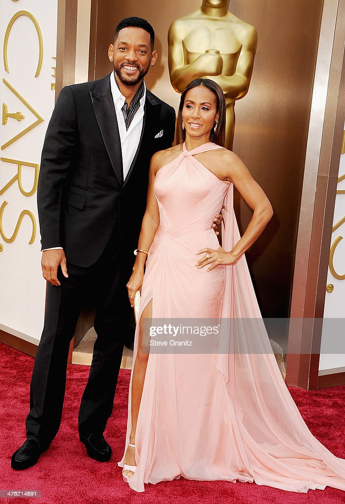 Actor Will Smith (L) and actress Jada Pinkett Smith attend the Oscars held at Hollywood & Highland Center on March 2, 2014 in Hollywood, California.