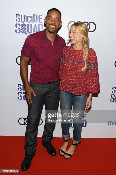 Actor Will Smith and actress Margot Robbie attend the grand opening of the 'Suicide Squad' Toronto Belle Reve Penitentiary Fan Experience cosponsored...