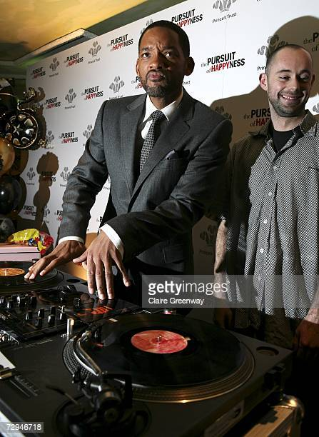 Actor Will Smith demonstrates his DJing skills with Prince's Trust beneficiary 'Area 51' DJ Adam Gibbs at a charity lunch in aid of The Prince's...
