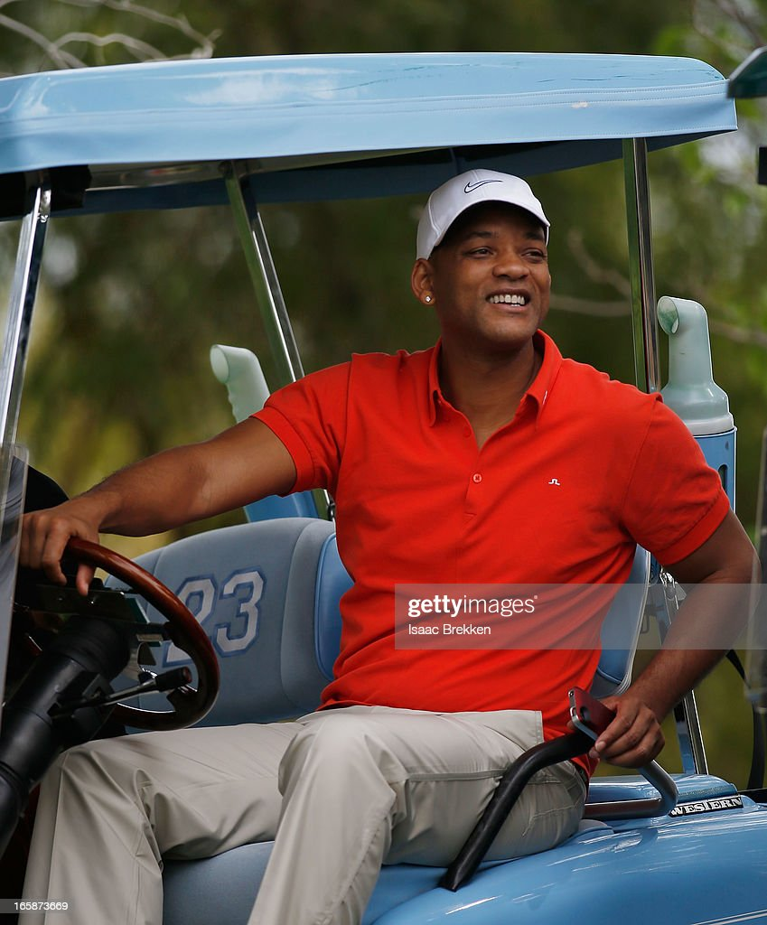 Actor <a gi-track='captionPersonalityLinkClicked' href=/galleries/search?phrase=Will+Smith&family=editorial&specificpeople=156403 ng-click='$event.stopPropagation()'>Will Smith</a> guest caddies for Michael Jordan during ARIA Resort & Casino's Michael Jordan Celebrity Invitational golf tournament at Shadow Creek on April 6, 2013 in North Las Vegas, Nevada.