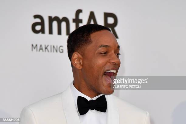 US actor Will Smith poses as he arrives for the amfAR's 24th Cinema Against AIDS Gala on May 25 2017 at the Hotel du CapEdenRoc in Cap d'Antibes...