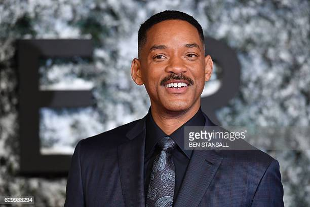 US actor Will Smith poses on the red carpet upon arrival at the European premiere of Collateral Beauty in London on December 15 2016 / AFP / Ben...