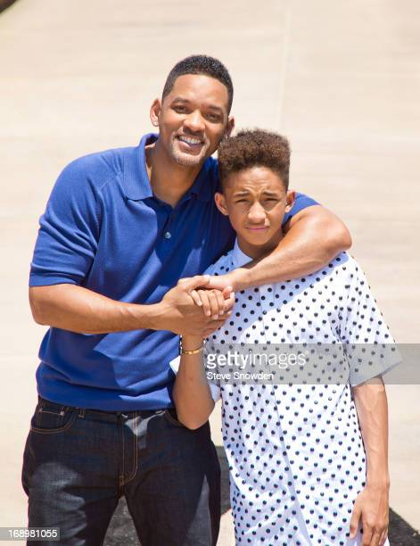 Actor Will Smith poses with his son and costar Jaden Smith outside the main entrance of Spaceport America during Colombia Pictures' 'After Earth'...