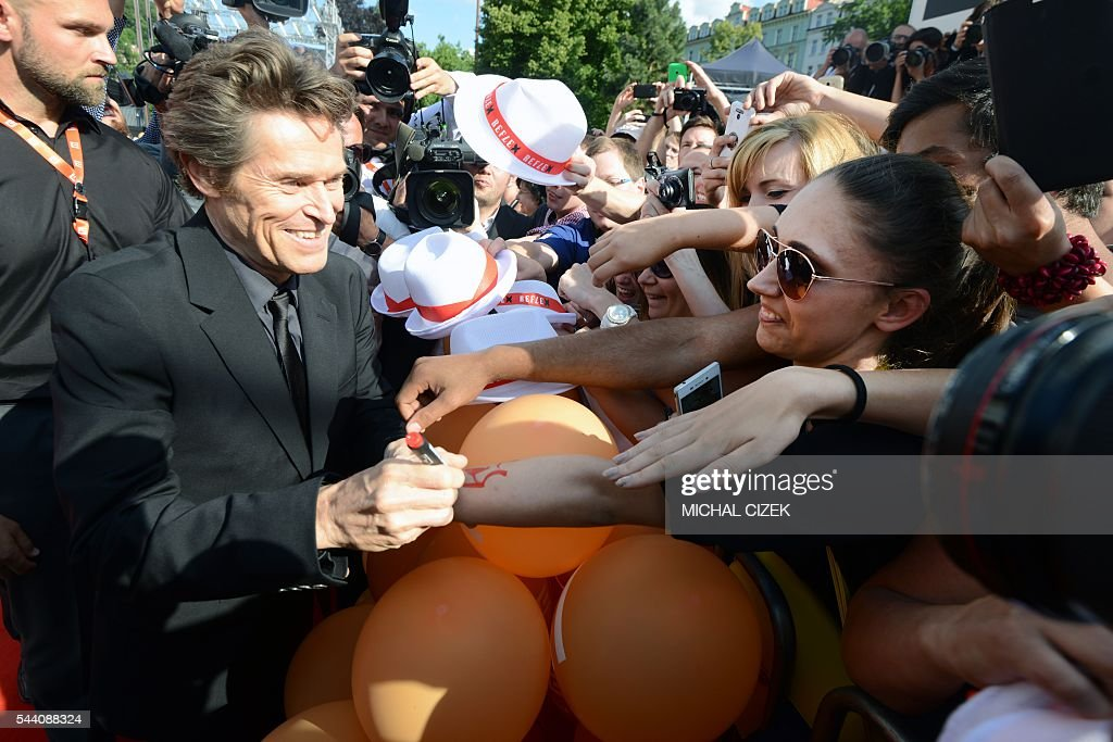 US actor Willem Dafoe signs autographs at the 51th Karlovy Vary International Film Festival (KVIFF) in Karlovy Vary, Czech Republic on July 1, 2016. / AFP / Michal Cizek