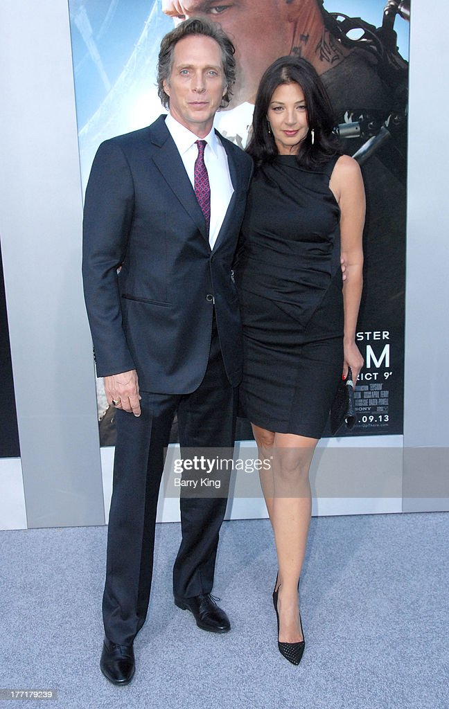 Actor William Fichtner (L) and Kymberly Kalil arrive at the Los Angeles Premiere of 'Elysium' on August 7, 2013 at Regency Village Theatre in Westwood, California.