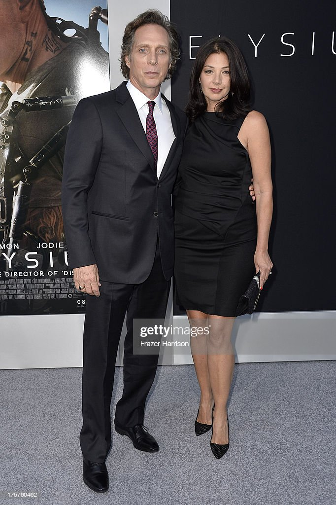 Actor William Fichtner and Kymberly Kalil arrives at the premiere of TriStar Pictures' 'Elysium' at Regency Village Theatre on August 7, 2013 in Westwood, California.