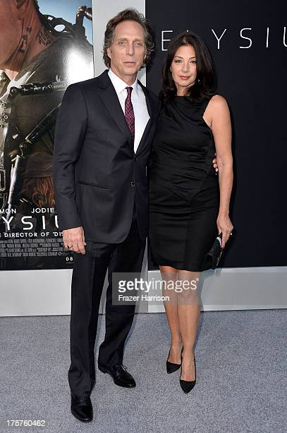 Actor William Fichtner and Kymberly Kalil arrives at the premiere of TriStar Pictures' 'Elysium' at Regency Village Theatre on August 7 2013 in...