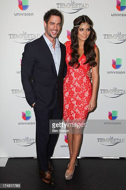 Actor William Levy and actress Ximena Navarrete attend the premiere of Univision's new telenovela 'La Tempestad' at Universal CityWalk on July 23...