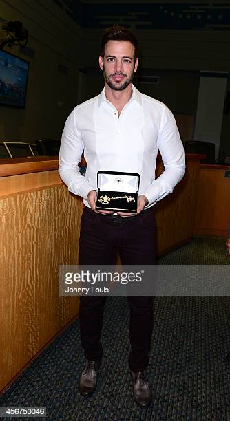 Actor William Levy receives a key to the city of Miami from Mayor Tomas Regalado on October 6 2014 in Miami Florida