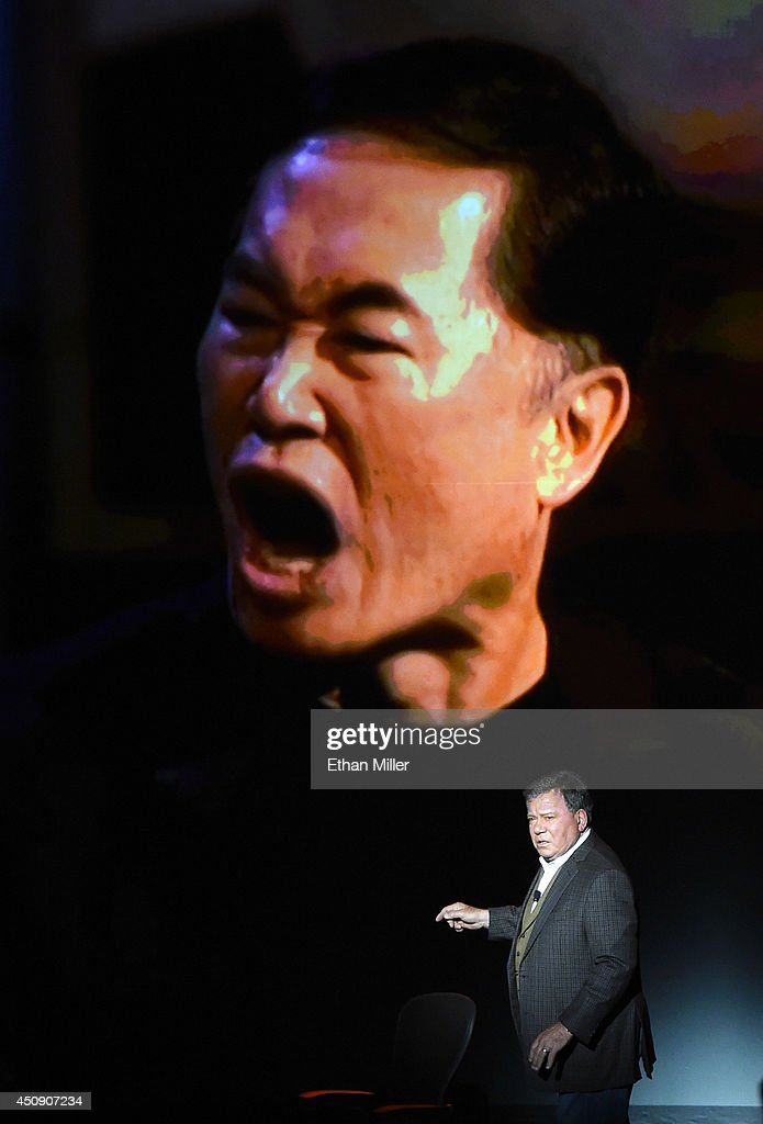 Actor <a gi-track='captionPersonalityLinkClicked' href=/galleries/search?phrase=William+Shatner&family=editorial&specificpeople=202461 ng-click='$event.stopPropagation()'>William Shatner</a> shows an image of actor <a gi-track='captionPersonalityLinkClicked' href=/galleries/search?phrase=George+Takei&family=editorial&specificpeople=1534988 ng-click='$event.stopPropagation()'>George Takei</a> from the 'Comedy Central Roast of <a gi-track='captionPersonalityLinkClicked' href=/galleries/search?phrase=William+Shatner&family=editorial&specificpeople=202461 ng-click='$event.stopPropagation()'>William Shatner</a>' during his one-man show, 'Shatner's World: We Just Live In It' at the MGM Grand Hotel/Casino on June 19, 2014 in as Vegas, Nevada.
