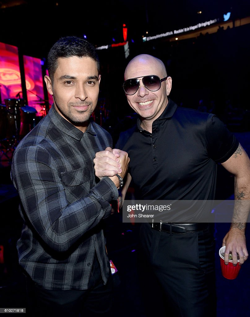 Actor Wilmer Valderrama (L) and recording artist Pitbull pose backstage at the 2016 iHeartRadio Music Festival at T-Mobile Arena on September 24, 2016 in Las Vegas, Nevada.