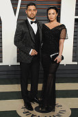 Actor Wilmer Valderrama and singer Demi Lovato arrive at the 2016 Vanity Fair Oscar Party Hosted By Graydon Carter at Wallis Annenberg Center for the...