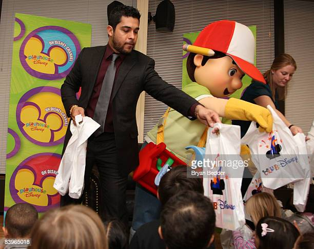 Actor Wilmer Valderrama and the 'Handy Manny' pass out gifts a special storytime with children of active duty service men and women at USO General...