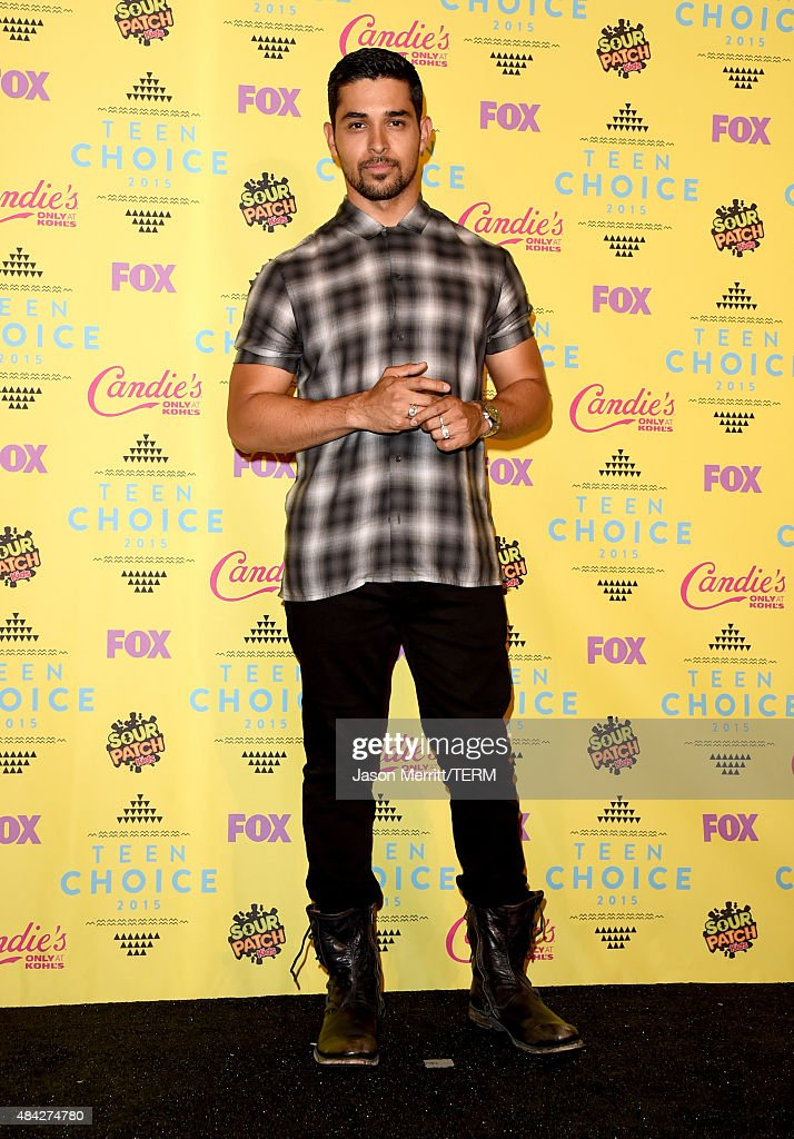 Actor Wilmer Valderrama poses in the press room during the Teen Choice Awards 2015 at the USC Galen Center on August 16, 2015 in Los Angeles, California.