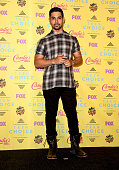 Actor Wilmer Valderrama poses in the press room during the Teen Choice Awards 2015 at the USC Galen Center on August 16 2015 in Los Angeles California