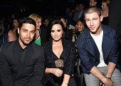 Actor Wilmer Valderrama singers Demi Lovato and Nick Jonas attend the 2016 Billboard Music Awards at TMobile Arena on May 22 2016 in Las Vegas Nevada