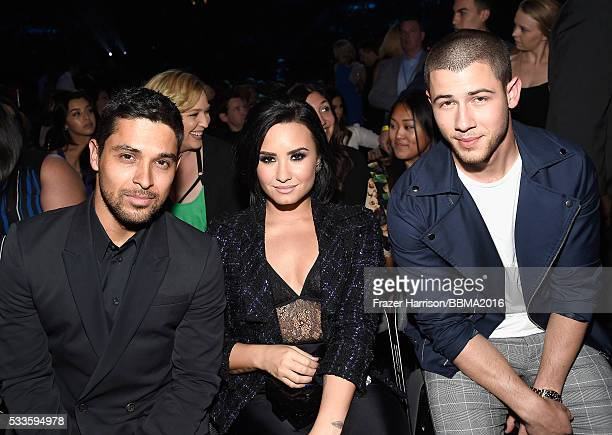 Actor Wilmer Valderrama singers Demi Lovato and Nick Jonas attend the 2016 Billboard Music Awards at TMobile Arena on May 22 2016 in Las Vegas Nevada