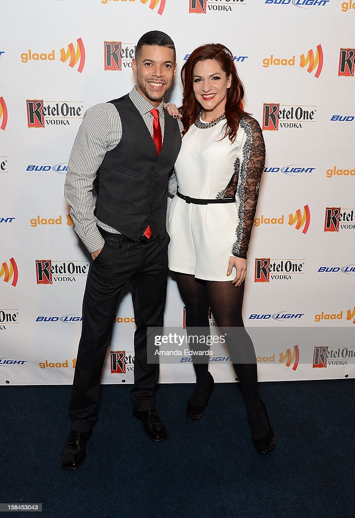 Actor Wilson Cruz (L) and broadway performer Shoshana Bean arrive at the GLAAD Tidings Annual Holiday Celebration at The London Hotel on December 16, 2012 in West Hollywood, California.