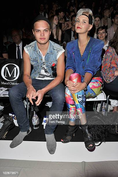 Actor Wilson Gonzalez Ochsenknecht and partner Bonnie Strange sit in front row at the Marcel Ostertag Show during the Mercedes Benz Fashion Week...