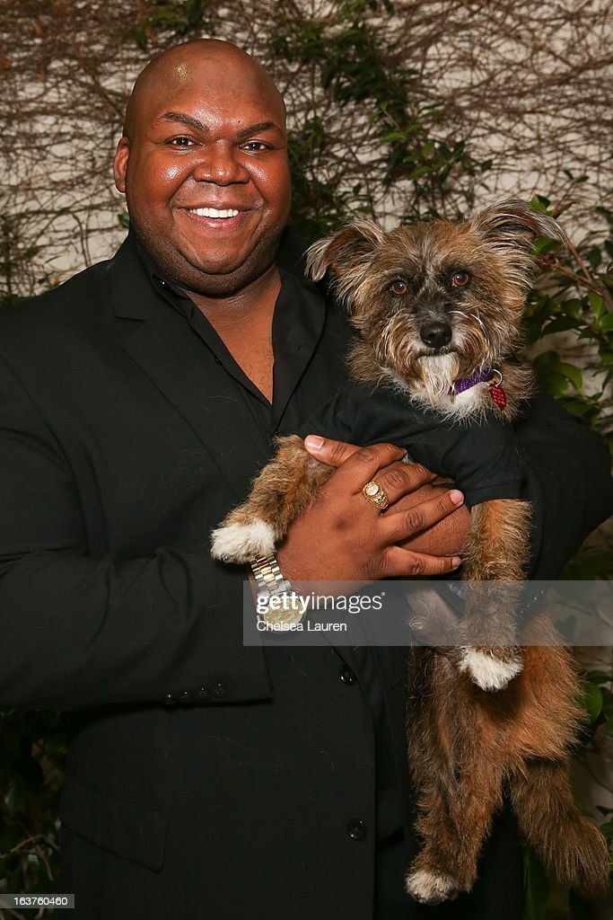 Actor Windell Middlebrooks poses with a dog wearing Lyric Culture for PetSmart at Much Love Animal Rescue's makeovers for mutts at Peninsula Hotel on March 14, 2013 in Beverly Hills, California.
