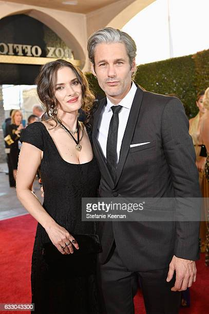 Actor Winona Ryder and Scott Mackinlay Hahn attend The 23rd Annual Screen Actors Guild Awards at The Shrine Auditorium on January 29 2017 in Los...