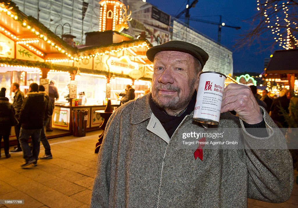 Actor Wolfgang Voelz collects donations during the 'Kartoffelpuffer-Brat-Charity' at the Berlin Christmas Market on November 26, 2012 in Berlin, Germany.