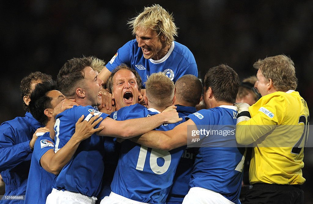 US actor Woody Harrelson (C) celebrates with teammates after scoring the winning penalty during the Unicef Soccer Aid charity football match between England and the Rest of the world at Old Trafford in Manchester, north-west England on June 6, 2010. Soccer Aid is the brainchild of Robbie Williams and all money raised through profits from ticket sales and donations made by viewers of ITVduring the match will go to UNICEF�s invaluable work helping children around the world.