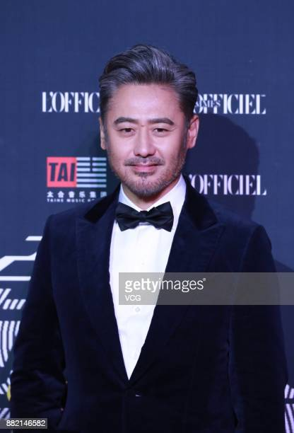 Actor Wu Xiubo arrives at the red carpet of L'Officiel Fashion Night 2017 on November 29 2017 in Beijing China