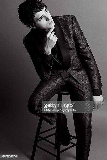 Actor Xavier Dolan is photographed for Madame Figaro on May 17 2015 at the Cannes Film Festival in Cannes France Suit shirt tie and shoes Makeup by...