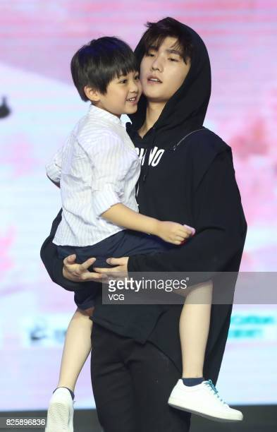 Actor Yang Yang and child star Peng Zisu attend the press conference of film 'Once Upon a Time' on August 3 2017 in Beijing China