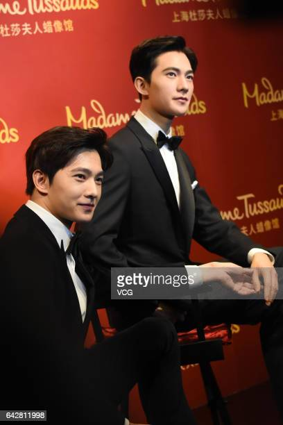 Actor Yang Yang poses with his wax figure at Shanghai Madame Tussauds on February 19 2017 in Shanghai China
