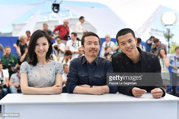 Actor Yang Zishan director Li Ruijun and actor Yin Fang attend the 'Walking Past The Future ' photocall during the 70th annual Cannes Film Festival...