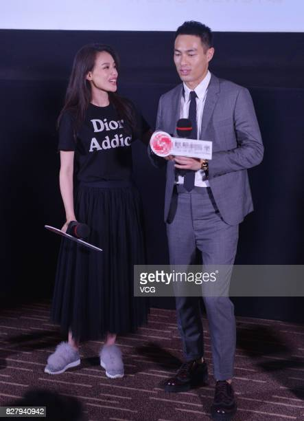 Actor Yo Yang and actress Shu Qi arrive at the red carpet of the premiere of 'The Adventurers' on August 8 2017 in Beijing China