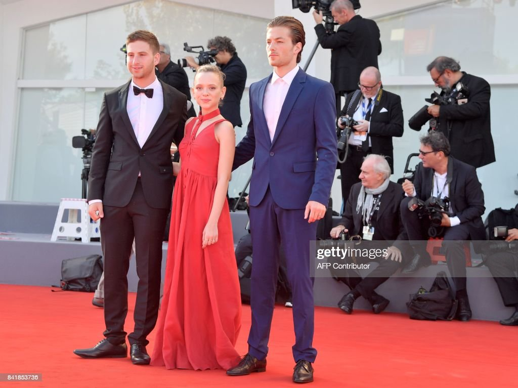 Actor Yonathan Shiray (L), actress Shira Haas and actor Gefen Barkai attend the premiere of the movie 'Foxtrot' presented in competition at the 74th Venice Film Festival on September 2, 2017 at Venice Lido. / AFP PHOTO / Tiziana FABI