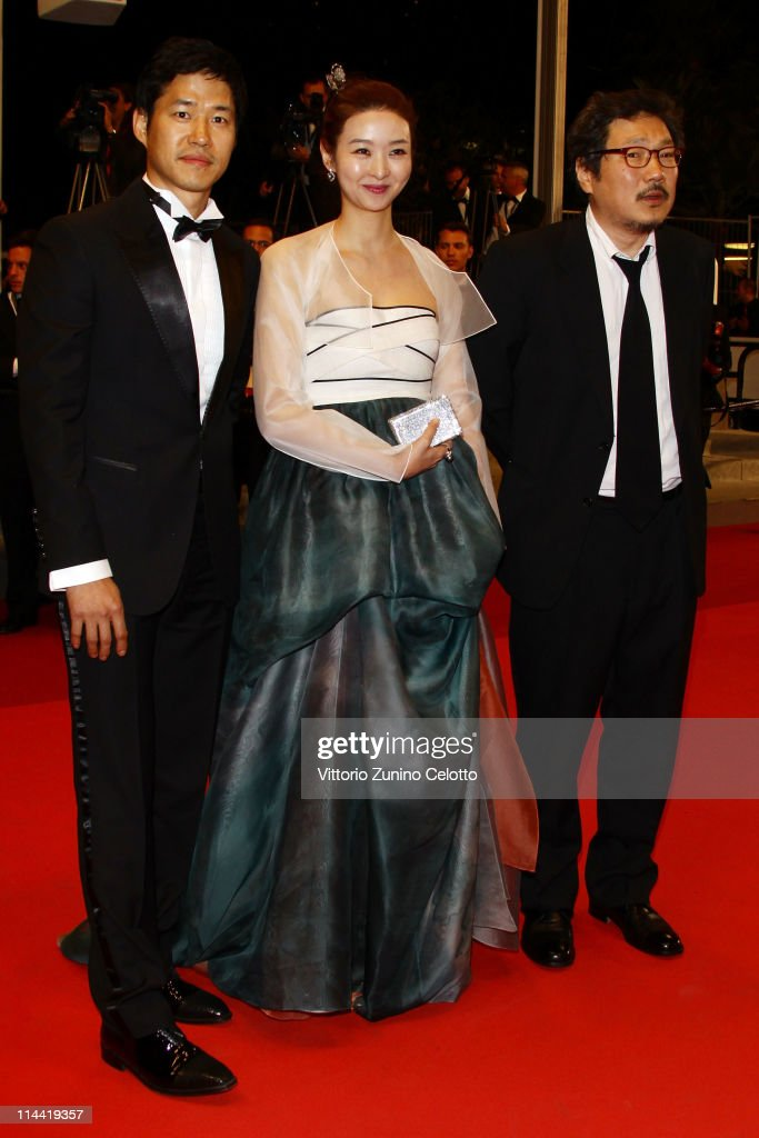 Actor Yu Jund-sang, actress Sun Mi Song and Hong Sang-soo attend the 'Hara-Kiri-Death Of A Samurai' premiere during the 64th Annual Cannes Film Festival at Palais des Festivals on May 19, 2011 in Cannes, France.