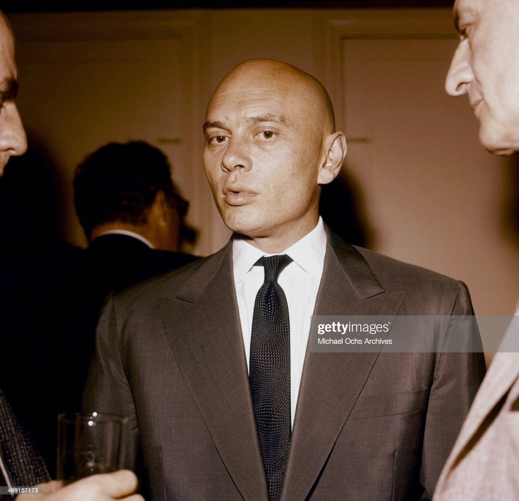 Actor <a gi-track='captionPersonalityLinkClicked' href=/galleries/search?phrase=Yul+Brynner&family=editorial&specificpeople=204712 ng-click='$event.stopPropagation()'>Yul Brynner</a> attends a party in Los Angeles, California.