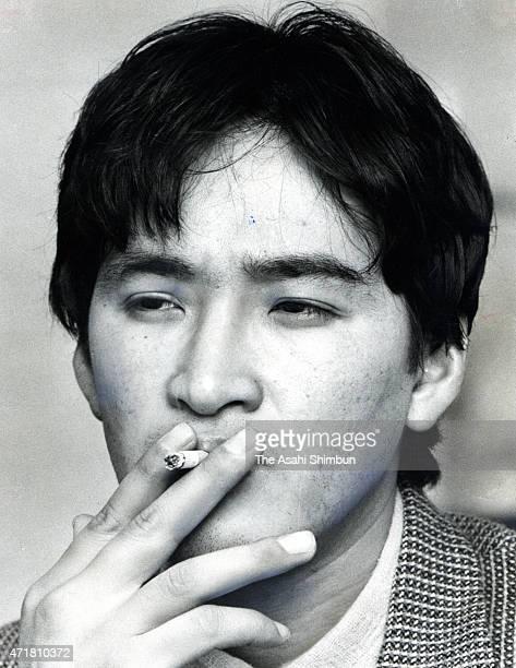 Actor Yusaku Matsuda smokes during the Asahi Shimbun interview at the Kanagawa Prefecture Youth Center on January 29 1984 in Yokohama Kanagawa Japan