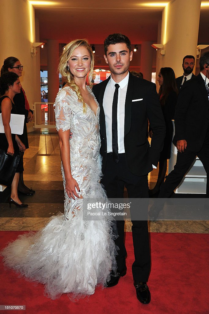 Actor <a gi-track='captionPersonalityLinkClicked' href=/galleries/search?phrase=Zac+Efron&family=editorial&specificpeople=533070 ng-click='$event.stopPropagation()'>Zac Efron</a> and actress Maika Monroe attend the 'At Any Price' premiere during the 69th Venice Film Festival at the Palazzo del Cinema on August 31, 2012 in Venice, Italy.