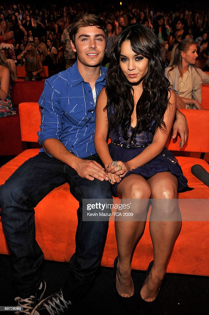 Actor <a gi-track='captionPersonalityLinkClicked' href=/galleries/search?phrase=Zac+Efron&family=editorial&specificpeople=533070 ng-click='$event.stopPropagation()'>Zac Efron</a> and actress Vanessa Hudgens sit in the audience during the Teen Choice Awards 2009 held at the Gibson Amphitheatre on August 9, 2009 in Universal City, California.