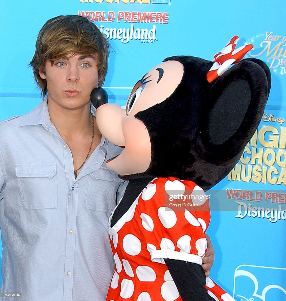 Actor <a gi-track='captionPersonalityLinkClicked' href=/galleries/search?phrase=Zac+Efron&family=editorial&specificpeople=533070 ng-click='$event.stopPropagation()'>Zac Efron</a> and Minnie Mouse arrive at Disney's 'High School Musical 2' world premiere at Downtown Disney on August 14, 2007 in Anaheim, California.